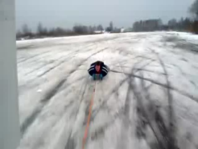 Child on a Sled Towed by a Car. Looks Fun Until...