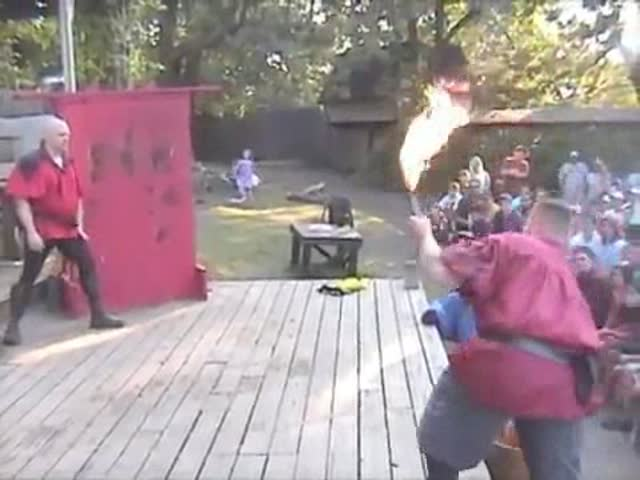 Man Catches a Flaming Knife Thrown at Him with His Bare Hands