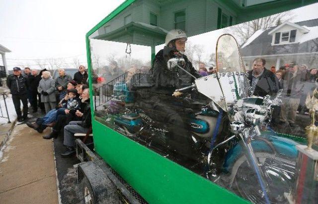 Biker Buried Riding His Harley Davidson