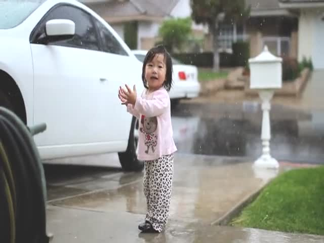 Cute Little Girl Playing in the Rain for the First Time