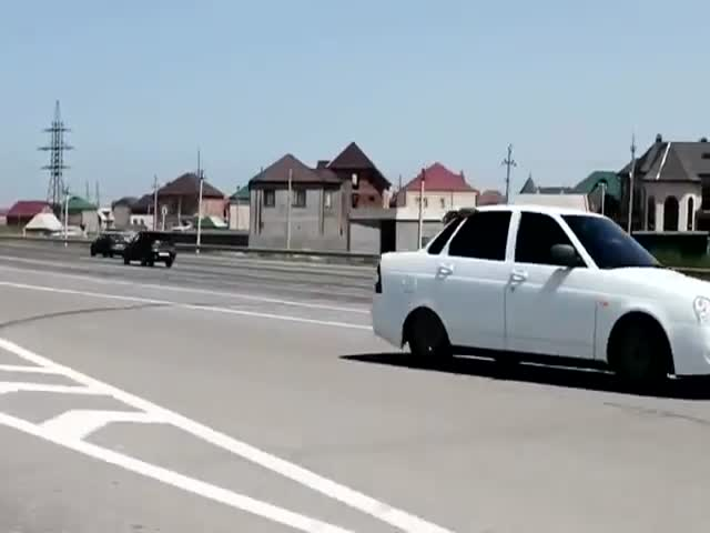 Driver in Convoy Wants to Show Off, Karma Hits Few Seconds Later
