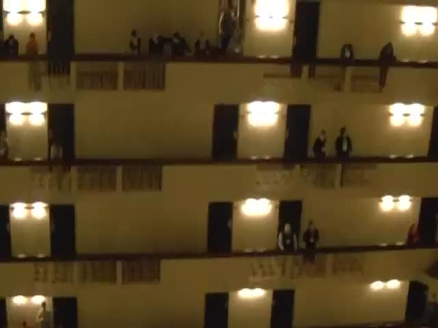 High School Students Sing the National Anthem in an 18-Story Hotel