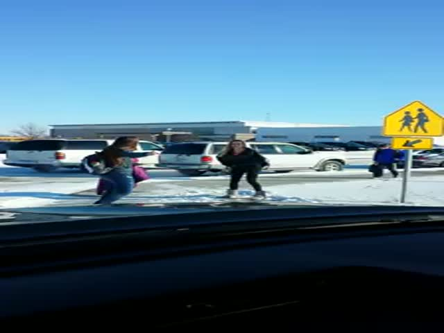 Father Has a Blast Watching Kids Slip and Slide on Ice