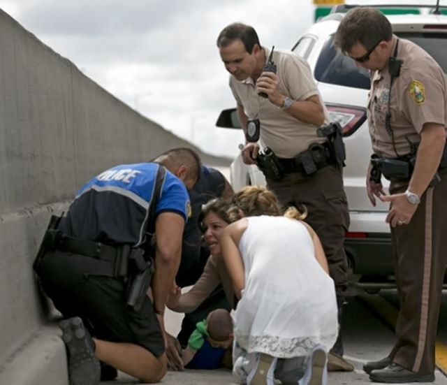 Strangers Come to a Baby's Rescue on Jammed US Expressway