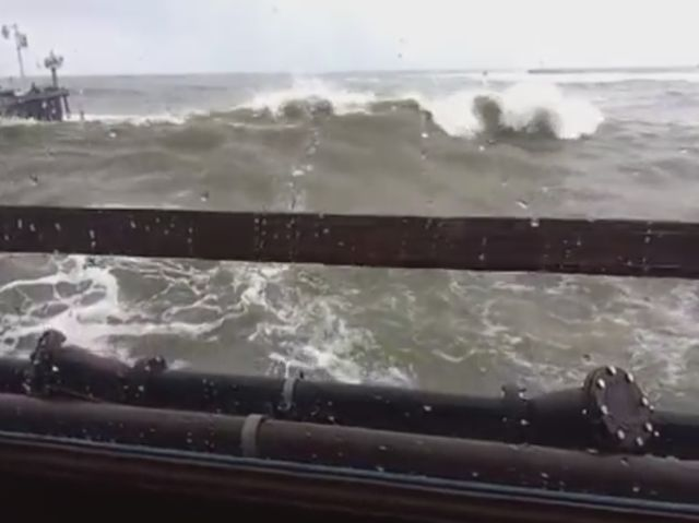 Huge Wave Crashes through Restaurant Windows