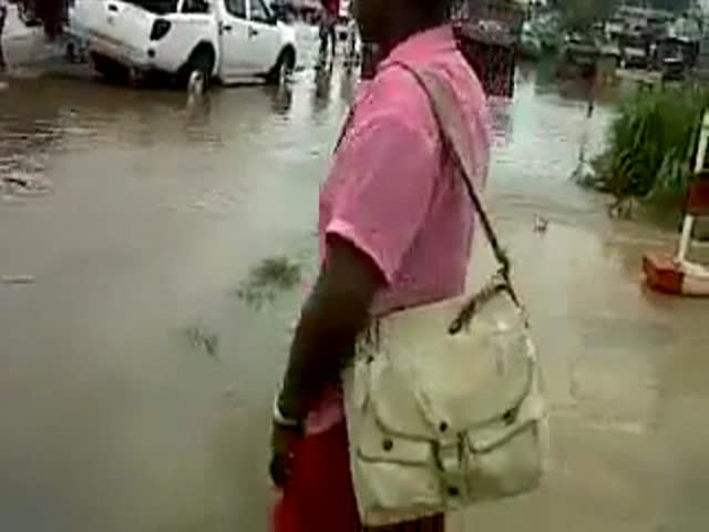 Woman Makes the Huge Mistake of Walking across a Flooded Street