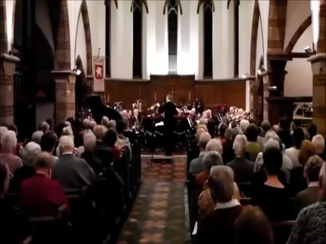 Musician Sneezes into His Trombone during Concert  (VIDEO)