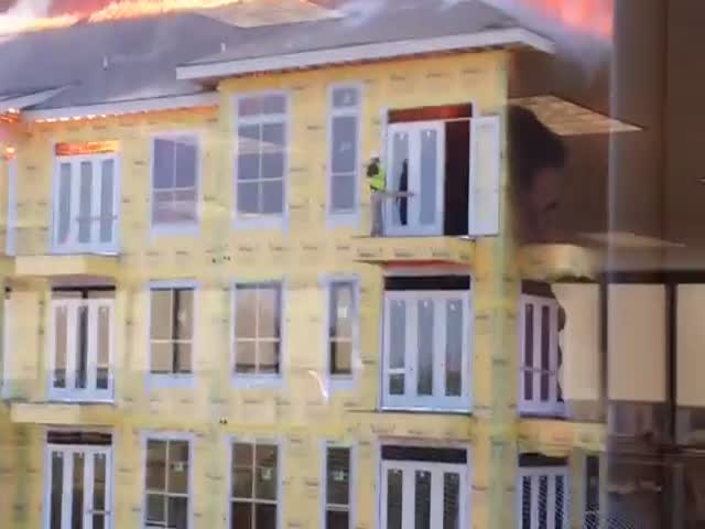 Worker Rescued Just in Time from Burning Building  (2 videos)