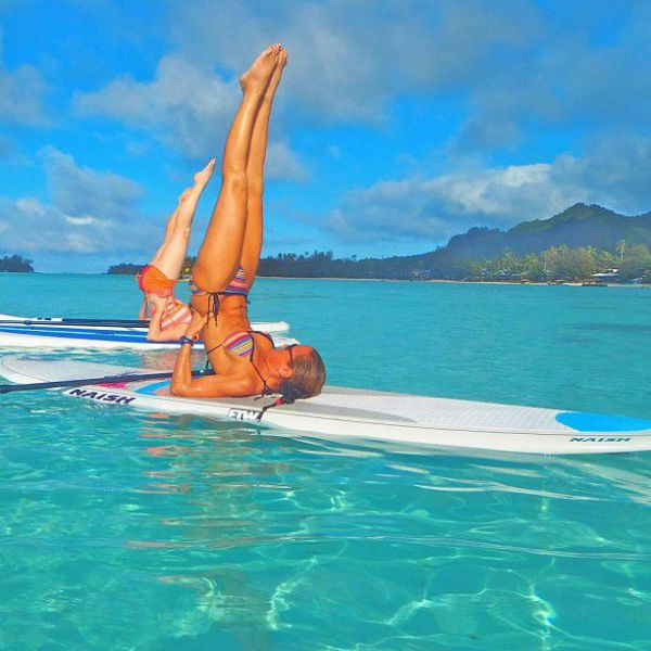 Surfboard Yoga Is a Fun New Form of Beach Exercise
