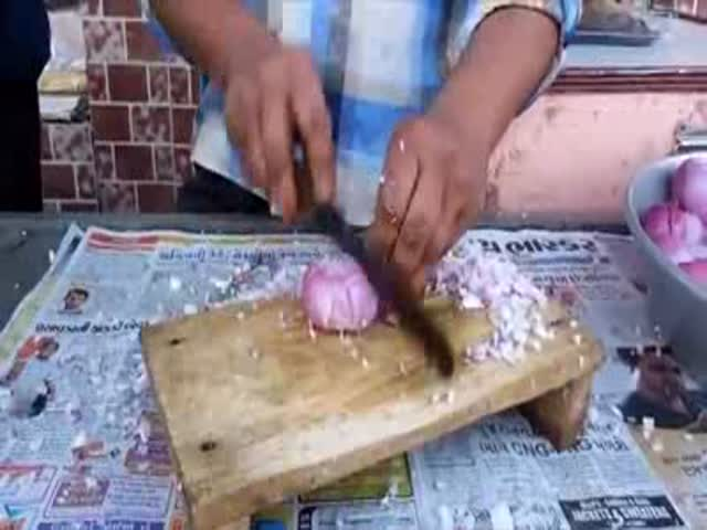 Indian Guy with Impressive Fast Chopping Skills