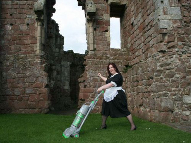 Women Practice Some Outdoor Vacuuming