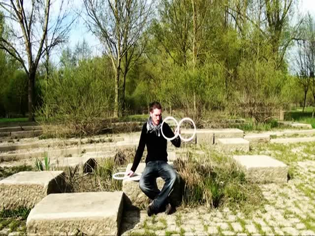 Mesmerizing Contact Juggling with 'Eight Rings'  (VIDEO)
