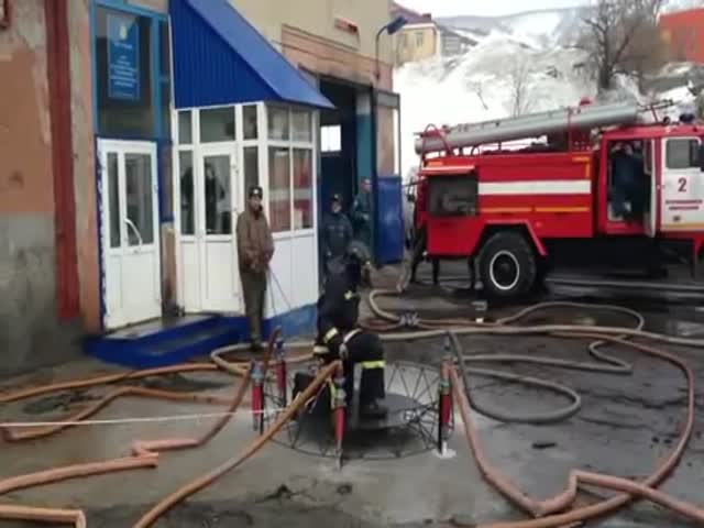 Meanwhile, in Russia: Firefighter on His Magic Carpet  (VIDEO)