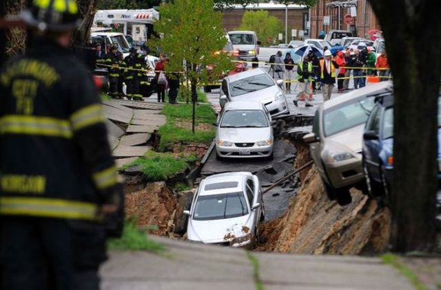 Road Collapses and Swallows Cars in the Process