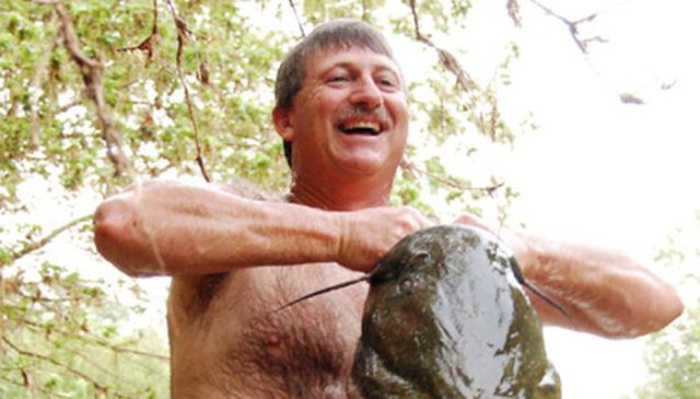 Giant Catfish Noodling Is an Odd Sport