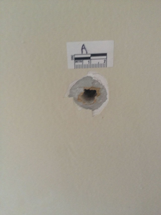 Police Bullet Sails Through This Dude's Bedroom Wall