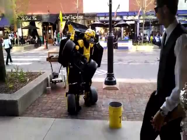 This Street Performer's Transformers Costume Actually Drives  (VIDEO)