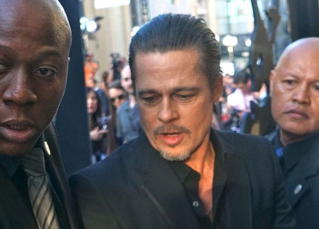 Brad Pitt Becomes a Victim of the Red Carpet Crasher at Maleficent Premiere