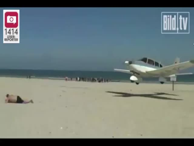 Plane Almost Lands on Guy Sunbathing on a Beach in Germany