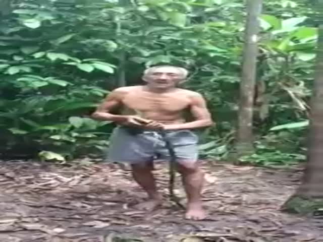 Elderly Man Shows How to Climb Up a Branchless Tree
