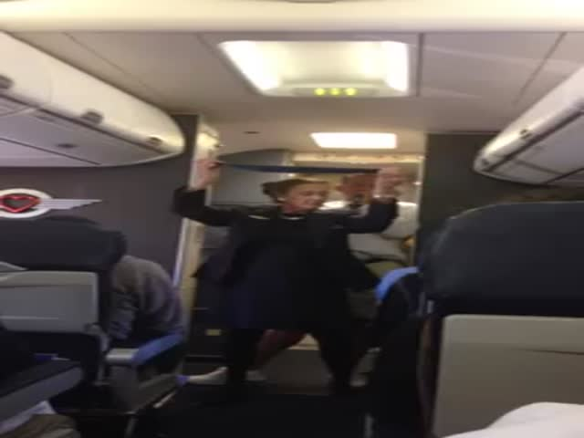 Flight Attendant's Hilarious Safety Speech  (VIDEO)