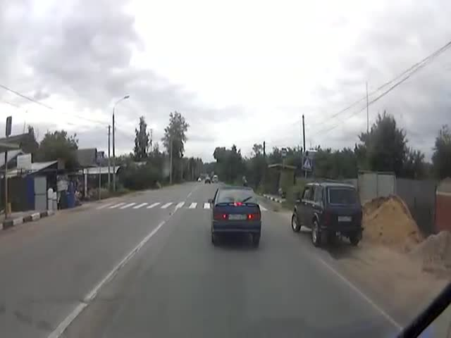 Russian Police Car Hits Pedestrian Using the Crosswalk