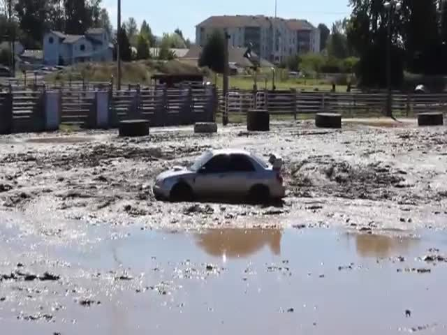 Mud Pit Is No Challenge for Powerful Subaru