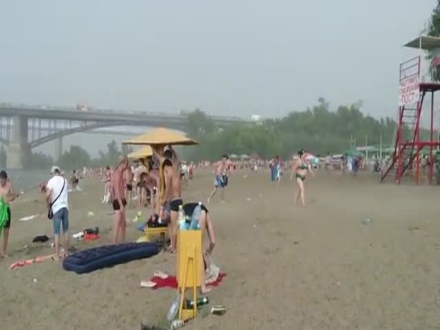 Sudden Hailstorm Surprises Beachgoers in Russia