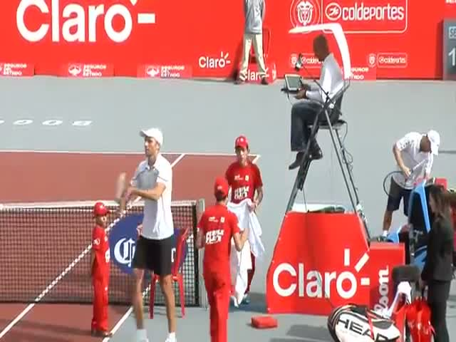 5'9'' Tennis Player Needs Some Help to Hug 6'11'' Opponent