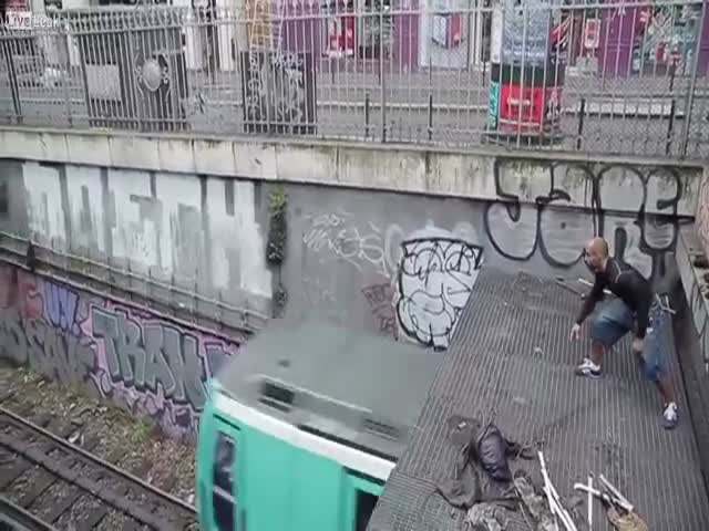 Crazy French Guy Leaps onto Speeding Metro Train