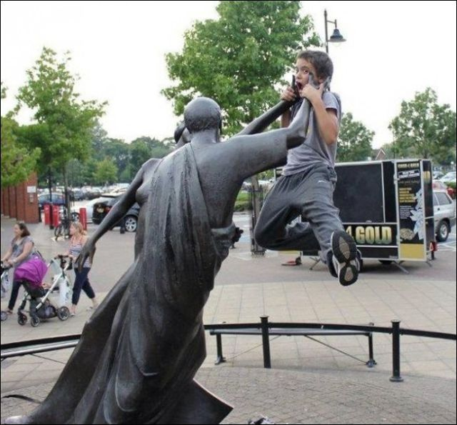 People Joking around with Statues and Monuments