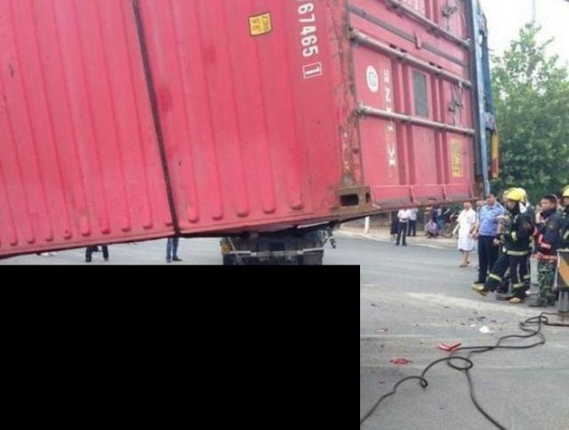 Container Truck Falls on a Car and Nearly Flattens It