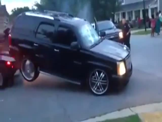 Crazy Woman Tries to Drive Her Car Away While It's Being Towed  (VIDEO)