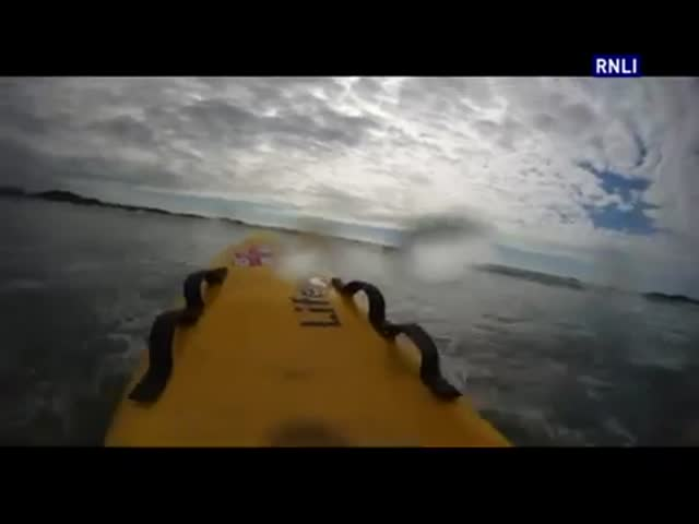 Lifeguard Rescues Boy from Rip Current - POV Footage  (VIDEO)