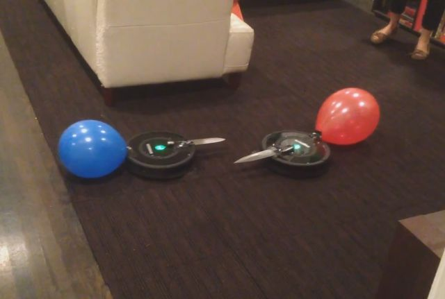 A Battle Between Two Roombas Both Equipped with a Knife and a Balloon