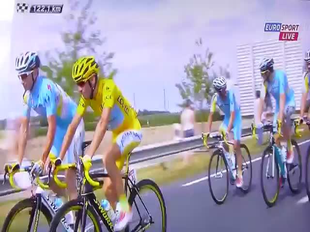 Random Guy Pops a Wheelie to Troll the Tour de France  (VIDEO)