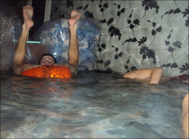 Guys Turn an Entire Apartment into Giant Swimming Pool