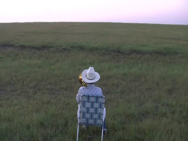 Kansas Farmer Serenades Cattle with Trombone Cover of Lorde's 'Royals'  (VIDEO)
