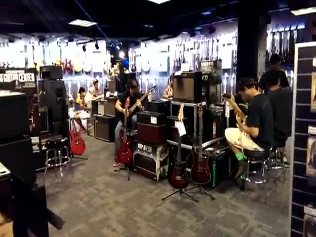 Visiting This Guitar Center That Opened in Times Square Is like Going to Hell