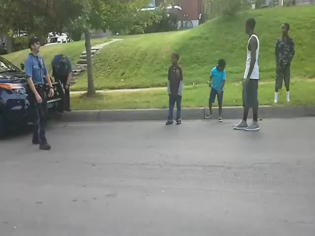 Police Officer Has Dance-Off with Neighborhood Kids