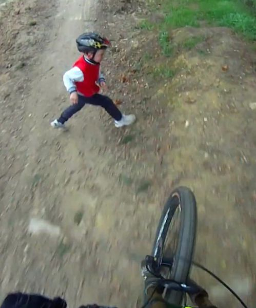 Mountain Biker Crashes into Kid on Active Bike Track