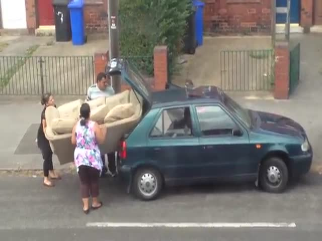 Family Struggling to Fit a Couch Inside Their Small Car