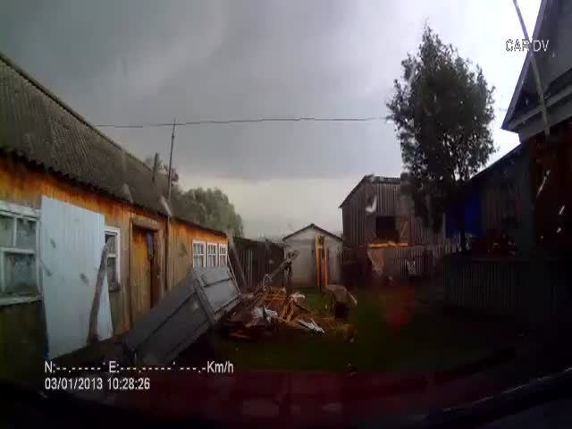 Car-Cam Records Tornado Wrecking Russian Village