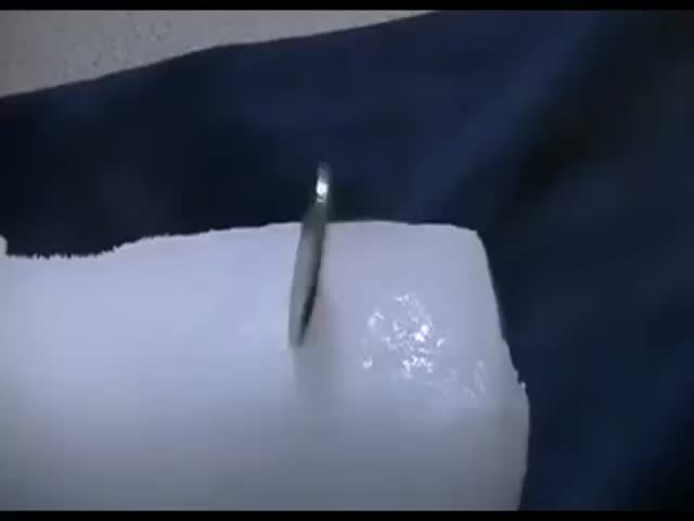 What Happens When You Insert a Coin into a Block of Dry Ice  (VIDEO)