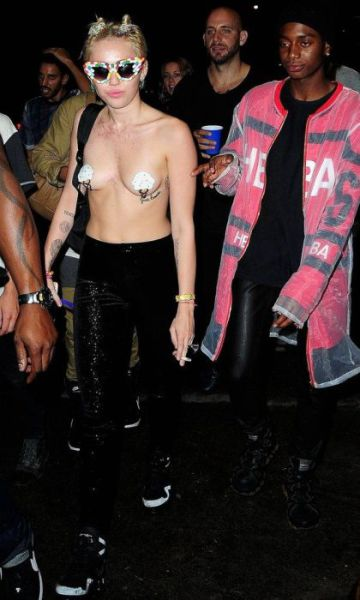 Miley Cyrus Parties Topless in Town
