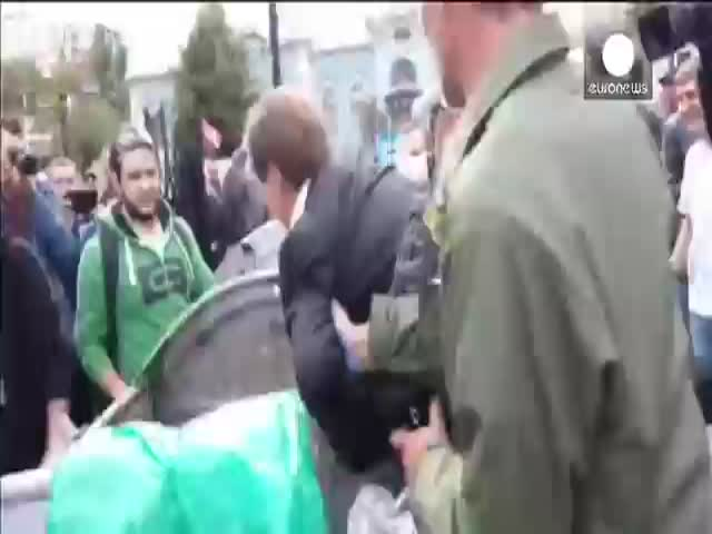 Angry Ukrainian Protesters Throw Politician into a Dumpster  (VIDEO)