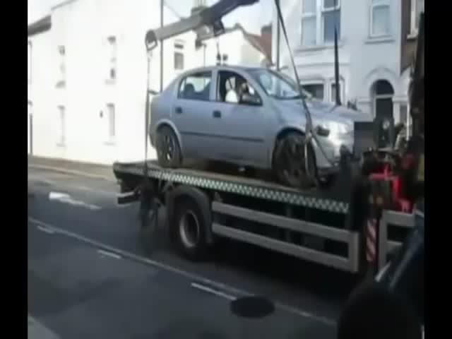 Car Driver Tries to Avoid Parking Fine