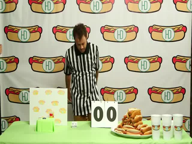 Hot Dog Eating Contest between Competitive Eater and a Tiny Hamster