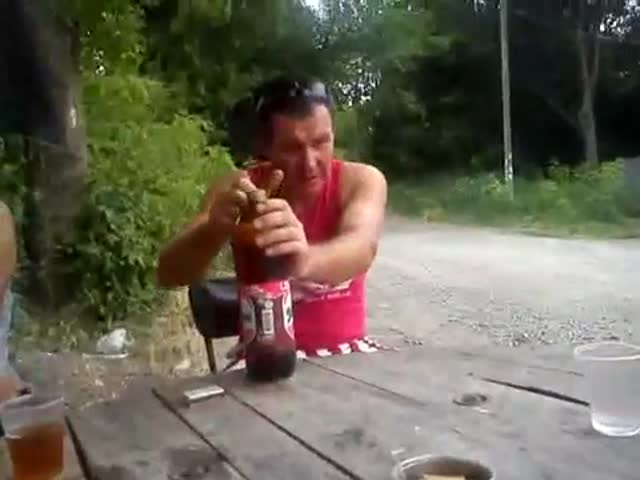 Drunk Russian Man Takes a Log in the Face