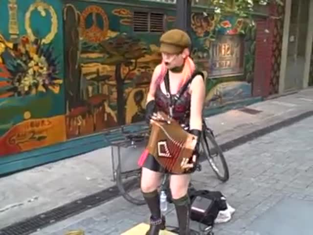 Punk Girl Plays the Accordion to Nuns in a Street of San Francisco